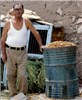 Restaurant owner in Chilean Atacama desert who stores chanar fruits to put in a blender with milk to make a beverage for his customers.