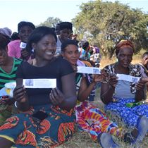 farmers displaying minifactsheets during a plant health rally in Zambia