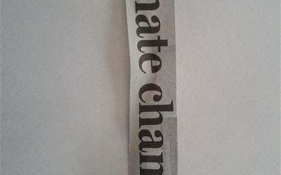Newspaper cutout from a climate change article