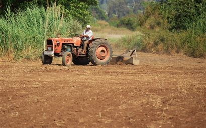 A tractor ploughing the soil.