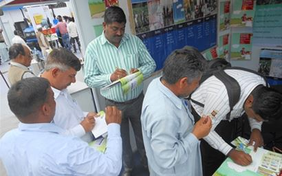 Farmers in Bihar, completing profile forms to subscribe to mKisan agro-advisory