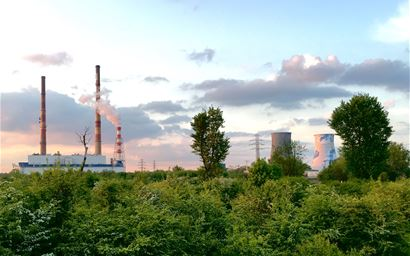 Power plants behind a forest