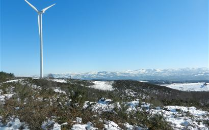 Wind turbine in a snowy landscape