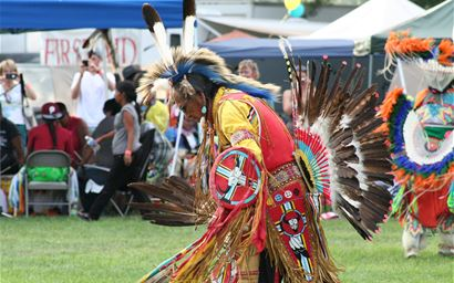 Native American dancer performing at pow-wow