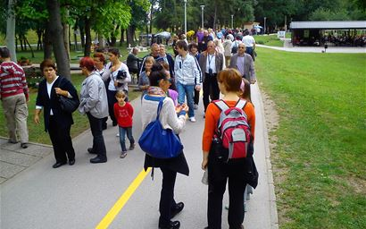 Groups of people walking in a park