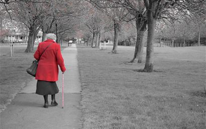 Elderly person walking in a park
