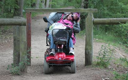 Wheelchair user trying to access a low gate