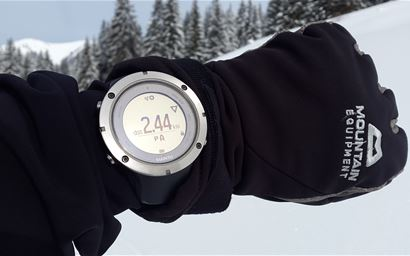 GPS device being used on snowy hillside