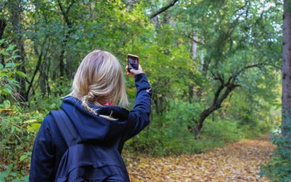 Hiker taking a selfie in the woods