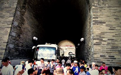 Coach party of Chinese tourists at historic attraction