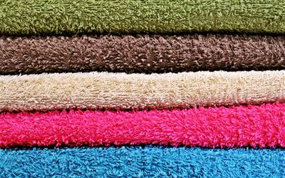 Pile of multi-coloured towels