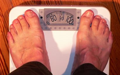 two feet on bathroom scales.