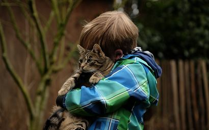 Child holding a cat