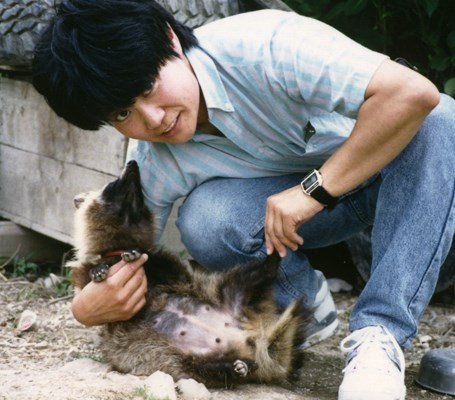 Researcher, Midori Saeki, with pregnant Raccoon dog in the month of June. Notice her submissive and 'tamed' attitude.