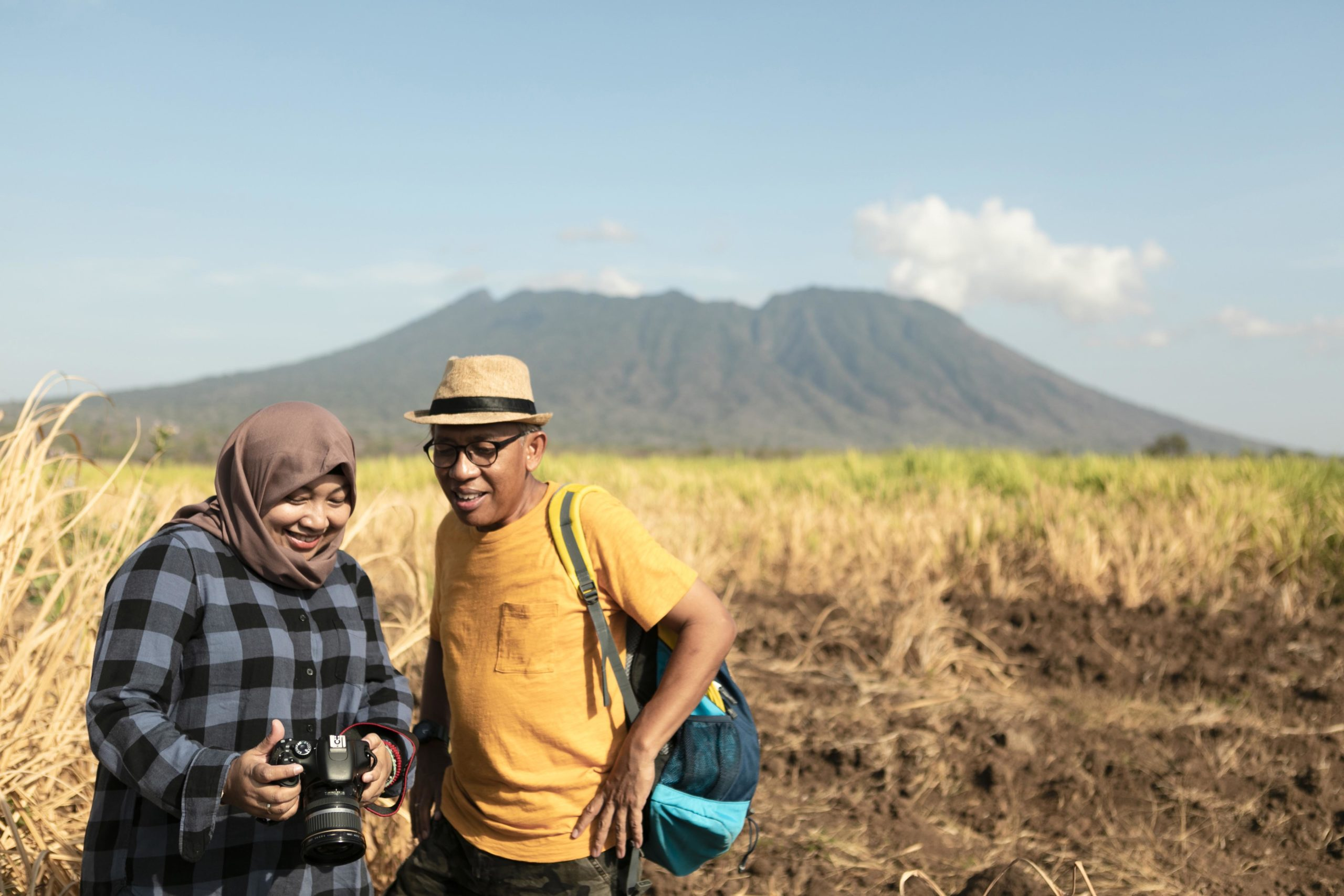 Hiking couple is resting after long trekking in baluran national park, banyuwangi, East Java, Indonesia